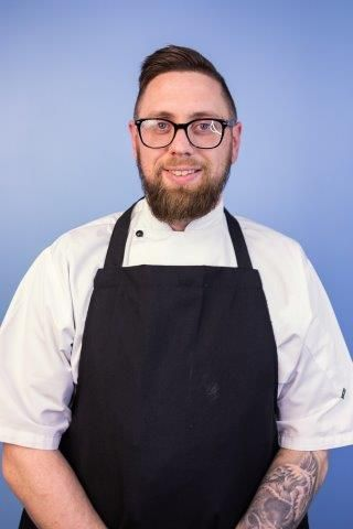 A chef wearing an apron