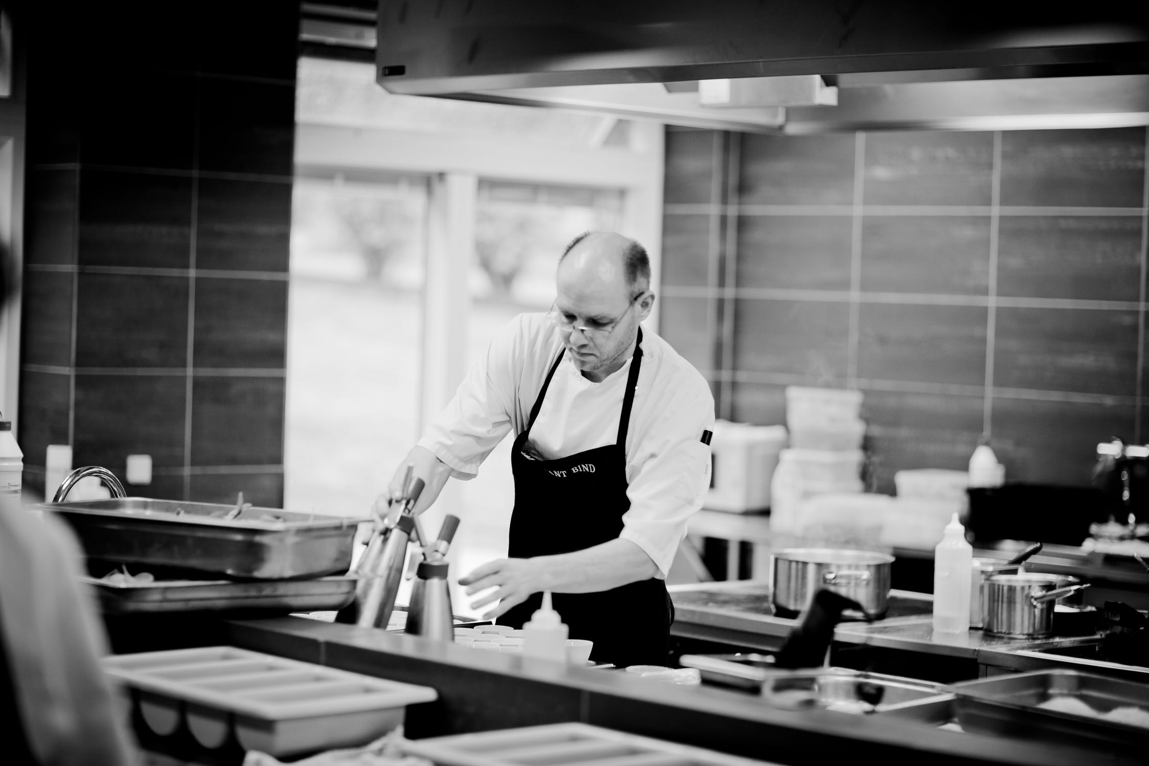 A chef in the kitchen concentrating hard